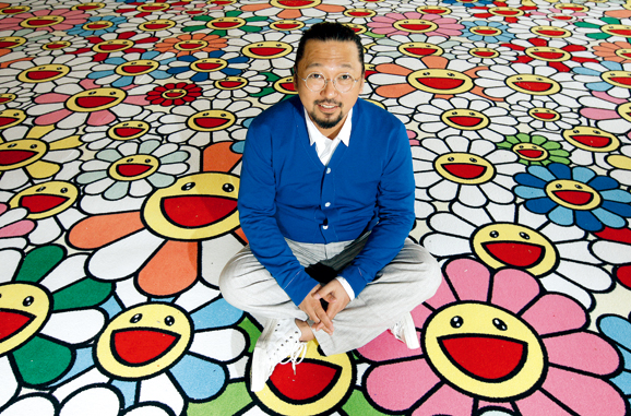 L'artiste japonais Takashi Murakami, pose devant l'une de ses oeuvres, expos�e au Ch�teau de Versailles. Ici, dans la salle des Gardes du Roi, sur sa moquette � fleurs assortie � sa toile Vacances Summer vacation.